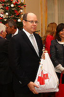 Prince Albert II Of Monaco hands out Christmas Gifts with Monaco Red Cross