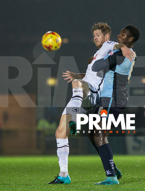 Jon Stead of Notts County holds off Aaron Pierre of Wycombe Wanderers during the Sky Bet League 2 match between Wycombe Wanderers and Notts County at Adams Park, High Wycombe, England on 15 December 2015. Photo by Andy Rowland.