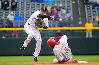 April 12, 2009: Rockies 2nd baseman Clint Barmes forces out Ryan Howard at 2nd base during a game between the Philadelphia Phillies and the Colorado Rockies at Coors Field in Denver, Colorado. The Phillies beat the Rockies 7-5.