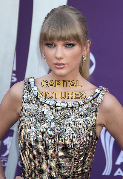 Taylor Swift.48th Annual Academy of Country Music Awards - Arrivals held at the MGM Grand Garden Arena, Las Vegas, NV., USA..April 7th, 2013.ACM headshot portrait fringe bangs hair gold silver sparkly embellished jewel encrusted half length .CAP/ADM/RE.©Russ Elliot/AdMedia/Capital Pictures.