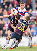 Picture by Allan McKenzie/SWpix.com - 08/04/2018 - Rugby League - Betfred Super League - Wakefield Trinity v Leeds Rhinos - The Mobile Rocket Stadium, Wakefield, England - Wakefield's Keegan Hirst is tackled by Leeds's Camerono Smith & Stevie Ward.