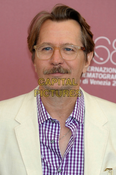 Gary Oldman.'Tinker, Tailor, Soldier, Spy' photocall  86th Venice Film Festival, Italy 5th September 2011.headshot portrait white purple gingham shirt glasses moustache mustache facial hair .CAP/PL.©Phil Loftus/Capital Pictures.