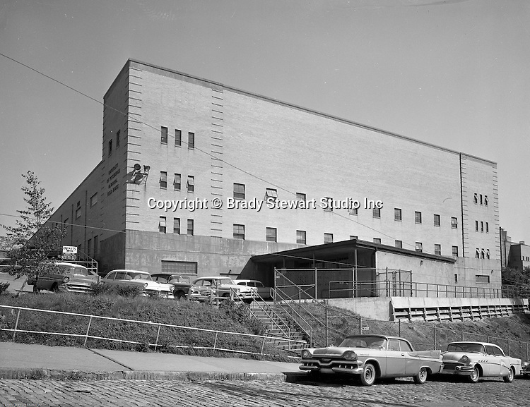 Pittsburgh PA:  View of the University of Pittsburgh Memorial Field House - 1958.  Completed in 1951, the field house was home for the Pitt Panthers basketball team, other Pitt athletic teams and the Duquesne Dukes from 1956-1964.   The name was changed to the Fitzgerald Field House in the late 1950s.  Building was designed by Ingham, Boyd and Pratt. They were one of the premier architects in Pittsburgh and did a lot of work for universities, hospitals and local school districts in the Pittsburgh area. The successor firm is IKM, Inc.