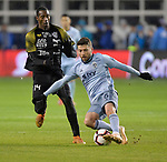 Abdiel Ayarza of Independiente (left) and Ilie Sanchez of Sporting KC vie for the ball. Sporting KC defeated Club Atletico Independiente 3-0 in a CONCACAF Champions League quarterfinal game at Children's Mercy Park on March 14, 2019.