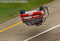 Apr 29, 2006; Talladega, AL, USA; Nascar Busch Grand National driver Tony Stewart of the (33) Old Spice Chevrolet Monte Carlo goes airborn after contact with Kenny Wallace during the Aarons 312 at Talladega Superspeedway. Stewart was unhurt in the incident. Mandatory Credit: Mark J. Rebilas-US PRESSWIRE Copyright © 2006 Mark J. Rebilas..