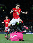 Angel Di Maria of Manchester United jumps over Chris Dunn of Cambridge Utd - FA Cup Fourth Round replay - Manchester Utd  vs Cambridge Utd - Old Trafford Stadium  - Manchester - England - 03rd February 2015 - Picture Simon Bellis/Sportimage