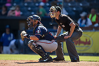 Rome Braves catcher Wigberto Nevarez (22) sets a target as home plate umpire Kyle Wallace looks on during the South Atlantic League game against the Asheville Tourists at McCormick Field on July 26, 2015 in Asheville, North Carolina.  The Tourists defeated the Braves 16-4.  (Brian Westerholt/Four Seam Images)