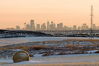 The sun sets on Calgary, Alberta, Canada on Saturday, January 15, 2005. Farmland north of the sprawling city awaits development as the province experiences continued economic growth.   .John Ulan/Epic Photography
