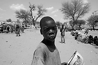 Beredjing refugee camp, Tchad, June 14, 2004.In less than 2 weeks this camp's population has swollen from 600 to 13000, an average of 1000 new arrivals show up every day...