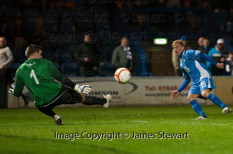Ayr Utd Goalkeeper Ally Brown saves at close range from Queen of the South's Gavin Reilly.