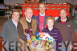 Val Moynihan, Michael John Dineen, Florie O'Mahony, Abina Kerins and Hugh Ryan working hard at the 39th annual Rathmore sale of work in Rathmore Community Centre on Sunday..