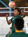 WATERBURY  CT. - 14 October 2019-101419SV08- #11 Kadin Talha of Holy Cross High heads a ball down the field against Naugatuck High during NVL Soccer action in Waterbury Monday. <br />Steven Valenti Republican-American