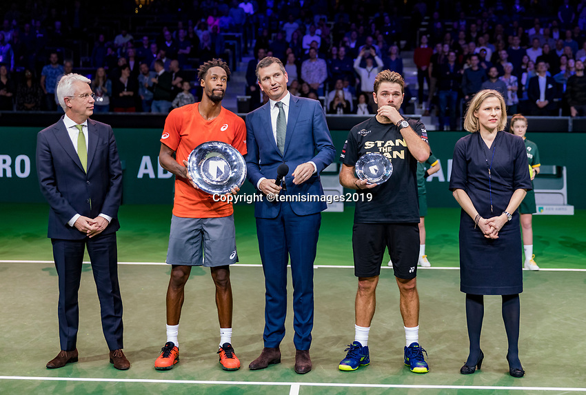 Rotterdam, The Netherlands, 17 Februari 2019, ABNAMRO World Tennis Tournament, Ahoy,  award ceremony, Winner Gael Monfils (FRA) and tournament director Richard Krajicek (M) looking at the name of the winner projected on the banner in the arena, next to Krajicek runner up Stan Wawrinka (SUI) and director of Ahoy Jolanda Jansen, left CEO of the ABNAMRO Bank Kees van Dijkhuizen <br /> Photo: www.tennisimages.com/Henk Koster