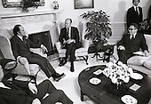 United States President Gerald R. Ford, center, meets Prime Minister Pierre Elliott Trudeau of Canada, left, in the Oval Office of the White House in Washington, DC on December 4, 1974.  US Secretary of State Henry A. Kissinger looks on from the right.  The meeting was centered around oil and livestock.  Canada recently decided to phase out exports of oil to the US.  The US and Canada will still meet to resolve the dispute over Canada's ban on certain beef imports from the US.  The ban prompted the President to retaliate against Canadian meat imports.<br /> Credit: Barry A. Soorenko / CNP