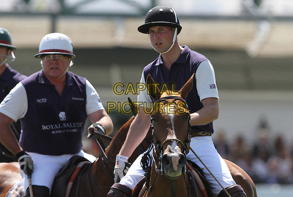 Prince William, Duke of Cambridge .Audi At The Foundation Polo Challenge held at the Santa Barbara Polo & Racquet Club, Santa Barbara, California, USA, 9th July 2011..half length royal tour royalty playing horse riding hat white trousers sport game .CAP/ADM/KB.©Kevan Brooks/AdMedia/Capital Pictures.