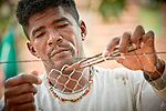 Valdir Guimaraes, 33, repairs a fishing net in Quilombo Bom Jardim near Santarem, Brazil. Soy plantations are encroaching on the community, and its way of life, which is based on fishing and small-scale farming, could be drastically changed if a large river port planned for the area is built.