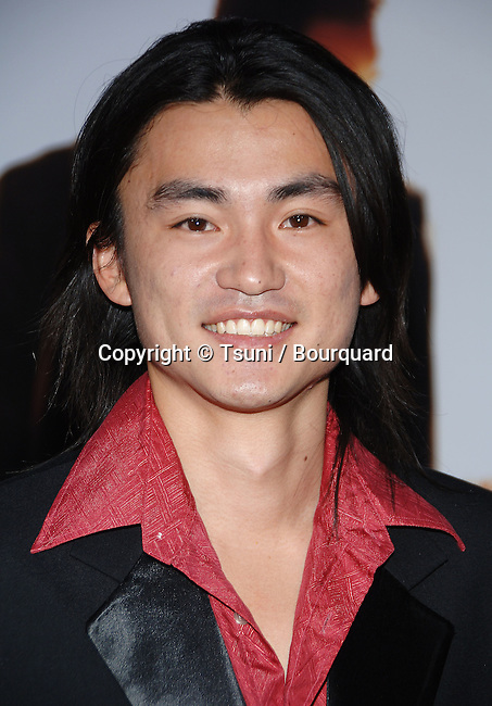 Shin Koyamata  arriving at the PURSUIT of Happiness Premiere at the Westwood Village Theatre In Los Angeles.<br /> <br /> headshot<br /> eye contact<br /> smile