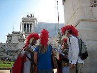 Cheesy centurion imitators with tourists, Rome.