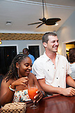 EXUMA, Bahamas. Guests enjoying a drink at the Hill House Bar at the Fowl Cay Resort.