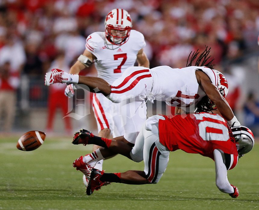 Ohio State Buckeyes wide receiver Philly Brown (10) can't hold on to a pass as he is hit by by Wisconsin Badgers safety Dezmen Southward (12) during Saturday's NCAA Division I football game at Ohio Stadium in Columbus on September 28, 2013. (Barbara J. Perenic/Columbus Dispatch)
