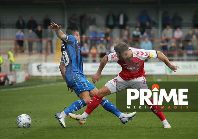 Wes Burns of Fleetwood Town challenges for the ball against Rochdale AFC during the Sky Bet League 1 match between Fleetwood Town and Rochdale at Highbury Stadium, Fleetwood, England on 18 August 2018. Photo by Stephen Gaunt / PRiME Media Images.