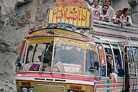 The passengers on the roof of a bus which is rocketing down the  Lowari Pass in the North West Frontier province of Pakistan seem perfectly comfortable despite the sheer drop to one side.
