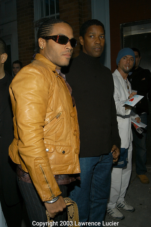 NEW YORK - SEPTEMBER 18: Recording artist Lenny Kravitz (L) and actor Denzel Washington arrive September 18, 2003, at the Zac Posen Spring/Summer 2004 Collection Fashion Show at the Chelsea Art Museum.