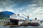 Alaska Marine Highway System ferry Columbia and Malaspina at shipyard, Ketchikan, SE Alaska, on a cloudy day.