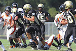 Palos Verdes, CA 09/22/11 - unknown Beverly Hills player(s) and Jordan Gates (Peninsula #9) and Noah Stettler (Peninsula #62)) in action during the Beverly Hills-Peninsula Varsitty Football gane.