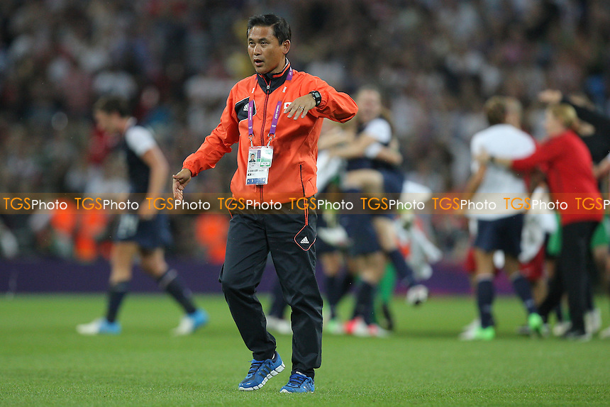 Japan coach Norio SASAKI gathers his players after the final whistle blows - USA Women vs Japan Women - Womens Olympic Football Tournament London 2012 Final at Wembley Stadium - 09/08/12 - MANDATORY CREDIT: Gavin Ellis/SHEKICKS/TGSPHOTO - Self billing applies where appropriate - 0845 094 6026 - contact@tgsphoto.co.uk - NO UNPAID USE.