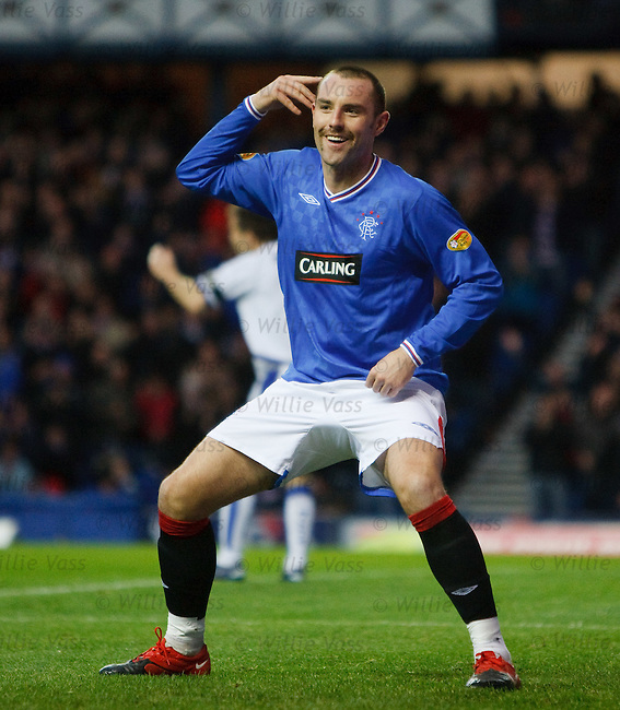 Kris Boyd listens for the applause after he scores for Rangers