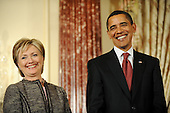 Washington, DC - January 22, 2009 -- United States President Barack Obama and his Secretary of State Hillary Clinton smile during an event where they announced the appointment of two new envoys to the Middle East, at the State Department  in Washington, DC, USA on 22 January 2009. Former Senator George Mitchell will serve as envoy to the Middle East and former Ambassador Richard Holbrook will serve Pakistan and India..Credit: Matthew Cavanaugh - Pool via CNP