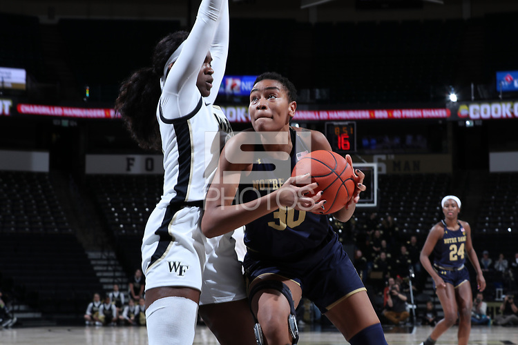 WINSTON-SALEM, NC - FEBRUARY 06: Mikayla Vaughn #30 of the University of Notre Dame drives the lane during a game between Notre Dame and Wake Forest at Lawrence Joel Veterans Memorial Coliseum on February 06, 2020 in Winston-Salem, North Carolina.