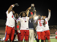 Manatee Hurricanes head coach Joe Kinnan (center) and team captains Clinton Heaven #20, Darius White #52, Leon Allen #7, Jalen Holmes #6, and Garrett Waiters #75 hoist the Championship trophy after the Florida High School Athletic Association 7A Championship Game at Florida's Citrus Bowl on December 16, 2011 in Orlando, Florida.  Manatee defeated First Coast 40-0.  (Mike Janes/Four Seam Images)
