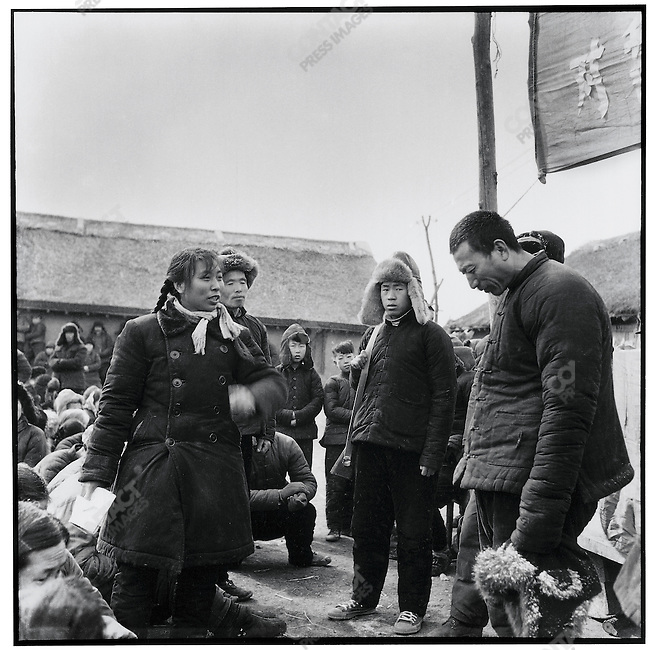 "Encouraged to make personal accusations against the denounced, a young woman attacks fellow peasant Zhang Diange for ""unreasonably"" pressuring her father to repay a debt on time.  Ashihe communes, Acheng county, 25 March 1965."
