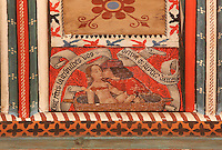 Detail of a man kissing a woman in her bath from the painted joisted ceiling in the abbey house, used as a private room for a priest, adjoining the chapterhouse, late 15th century, in the Saint-Hilaire-D'Aude Abbey, built 11th - 14th centuries and closed 1748, when it became a parish church, Saint-Hilaire, Aude, Languedoc-Roussillon, France. St Hilary built the first chapel on this site in the 6th century. In the 10th century his relics were discovered here and the church, then an abbey, rededicated to him. Picture by Manuel Cohen