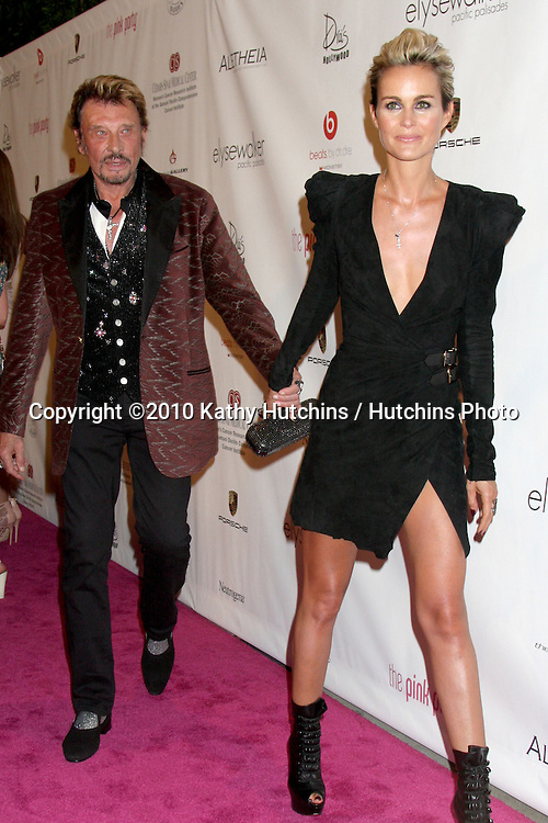 LOS ANGELES - SEP 25:  Johnny Hallyday & wife Laeticia Hallyday arrives at the Pink Party 2010 at W Hollywood Hotel on September 25, 2010 in Los Angeles, CA