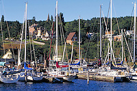 Marina, sailboats, Victorian homes overlooking Bayfield waterfront. Bayfield Wisconsin USA Lake Superior.