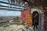 Natanel walks out of his house, at the unauthorized Israeli settler-outpost of Chavat Gilad, West Bank.