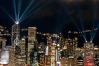 Laser show over city at night, Hong Kong, China.
