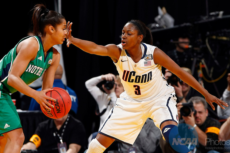 03 APR 2011:  Tiffany Hayes (3) of the University of Connecticut pressures Skylar Diggins (4) of the University of Notre Dame during the Division I Women's Basketball Semifinals held at Conseco Fieldhouse in Indianapolis, IN.  Notre Dame defeated UConn 72-63 to advance to the national title game.  Jamie Schwaberow/NCAA Photos