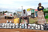 Donald Wambau and Purity Nathan sell second hand sneakers to  athletes in Iten. The running shoes, imported from Europe and the United States are offered at a fraction of the Price of new trainers.