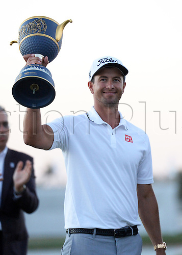 06.03.2016. Doral, Florida, USA.  Adam Scott from Australia raises the trophy during the awards presentation at the completion of the final round of the World Golf Championships-Cadillac Championships - Final Round at Trump National Doral in Doral, FL