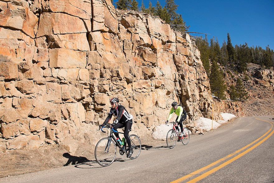Cyclists ride up Golden Gate Canyon in Yellowstone National Park during the spring biking season.