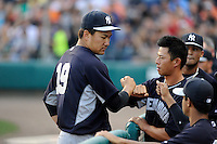 Starting pitcher Masahiro Tanaka (19) of the New York Yankees fist bumps a teammate as he is removed from a Spring Training game against the Atlanta Braves on Wednesday, March 18, 2015, at Champion Stadium at the ESPN Wide World of Sports Complex in Lake Buena Vista, Florida. The Yankees won, 12-5. (Tom Priddy/Four Seam Images)