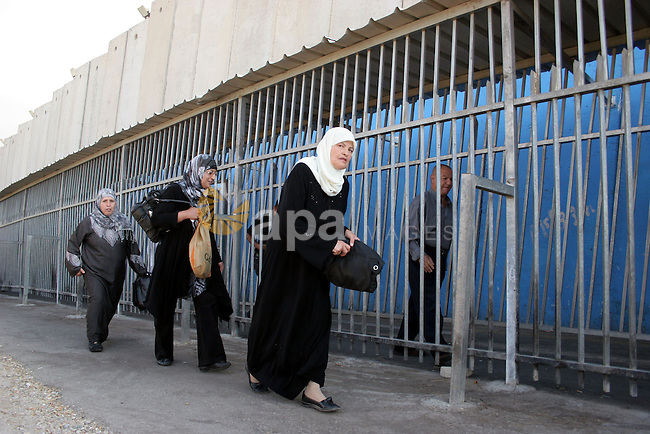 Palestinian women walk in line to cross from the Qalandia checkpoint that leads from the West Bank town of Ramallah to Jerusalem on 05 August 2011, in order to attend the Friday prayers in the holy Muslim month of Ramadan at the Al-Aqsa Mosque in Jerusalem. The Israeli Army limited the age of Palestinians who can enter Jerusalem for men over the age 50. Photo by Najeh Hashlamoun.