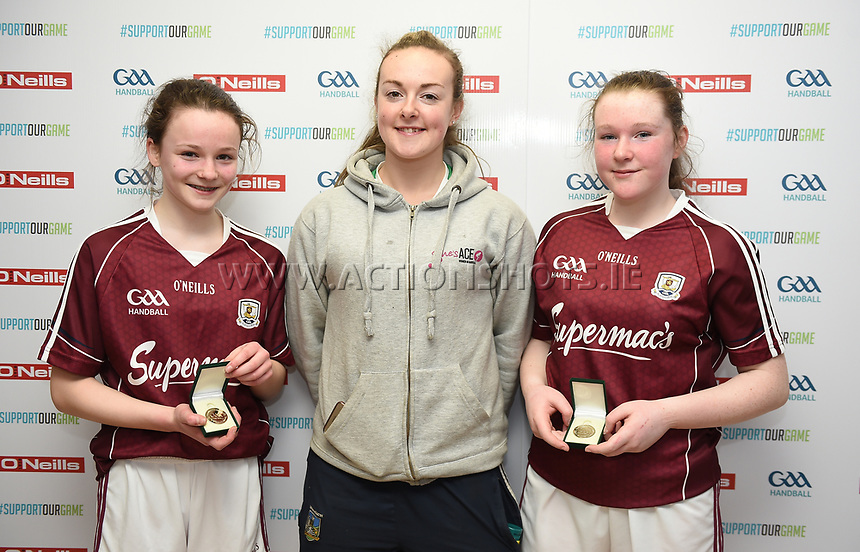 19/03/2018; 40x20 All Ireland Juvenile Championships Finals 2018; Kingscourt, Co Cavan;<br /> Girls Under-14 Doubles; Galway (Sky Ni Mhaille Breathnach/Eadaoin Nic Dhonnacha) v Tyrone (Dearbhla Fox/Cl&oacute;da Nic Con Midhe)<br /> Winners Sky Ni Mhaille Breathnach and Eadaoin Nic Dhonnacha with Martina McMahon<br /> Photo Credit: actionshots.ie/Tommy Grealy