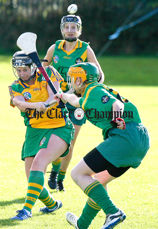 131012.Inagh/Kilnamonas Noelle Bergin clears under pressure from Kilkishens Clodagh O'Halloran during the Glenomra Senior Shield at Clarecastle.