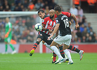 Southampton's Nathan Redmond under pressure from Burnley's Ashley Westwood<br /> <br /> Photographer Kevin Barnes/CameraSport<br /> <br /> The Premier League - Southampton v Burnley - Sunday August 12th 2018 - St Mary's Stadium - Southampton<br /> <br /> World Copyright &copy; 2018 CameraSport. All rights reserved. 43 Linden Ave. Countesthorpe. Leicester. England. LE8 5PG - Tel: +44 (0) 116 277 4147 - admin@camerasport.com - www.camerasport.com