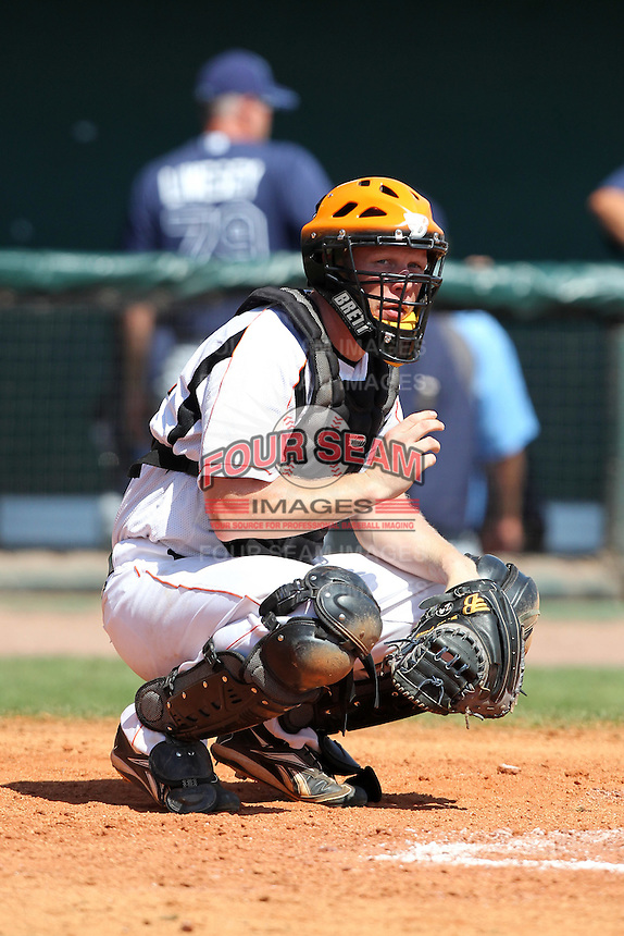 Netherlands catcher Sidney Jong de #24 during a game vs. the Tampa Bay Rays for an exhibition game at Al Lang Field in St. Petersburg, Florida;  March 9, 2011.  Tampa Bay defeated Netherlands 4-3.  Photo By Mike Janes/Four Seam Images